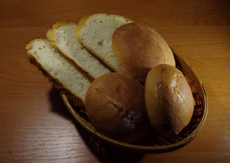 breadbasket: Sliced bread and slider buns in wicker breadbasket