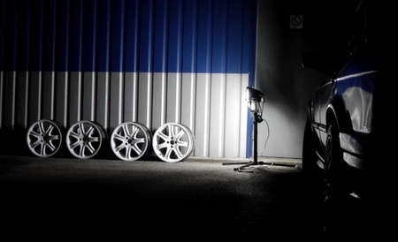 Set of dismantled white sport car wheels near car tyre service workshop