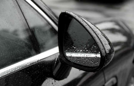 water repellent: Water drops on car mirror after rain protection coating stock photos