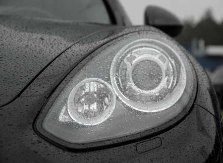 water repellent: Water drops on car headlights after rain protection coating stock photos