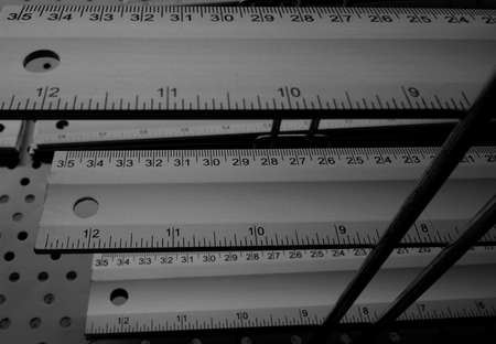 inch: Centimeter and inch rulers on the shelf of hardware shop