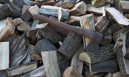 stack of firewood: Old axe on stack firewood logs texture background