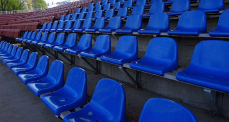 seating: Plastic seating section on the grandstand of sport stadium Stock Photo