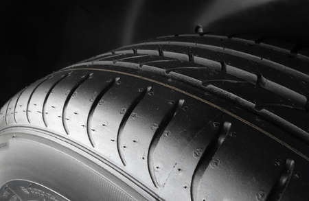 tread: Tread block pattern of symmetrical tire macro shot