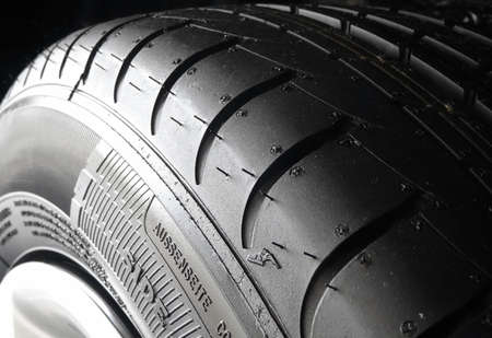 sidewall: Sipes and grooves on summer tire closeup Stock Photo