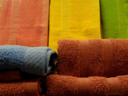 toweling: Stacks of colorful folded towels on wiper cloths background