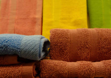 toweling: Stacks of colorful folded towels studio isolated