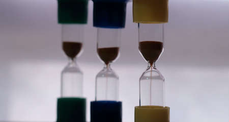 royalty free: Trickle of sand in the variety hourglass macro shot royalty free stock image Stock Photo
