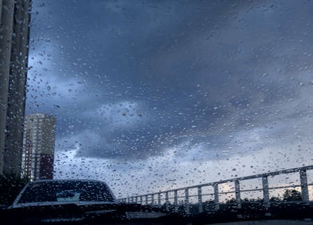 water repellent: View on city buildings through windshield with rain drops