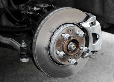 Brake service inspection. Damaged brake disc and pads on classic vehicle Stock Photo
