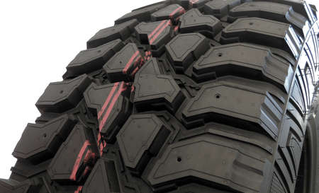 traction: Off road tire tread design and deep sipes close up stock photo