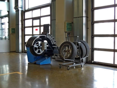 Tires preparing to seasonal changing on the fitting machine