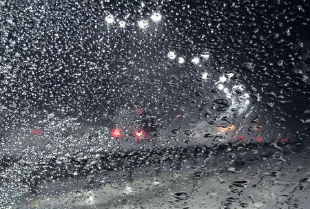 Frozen Snow On The Windshield Of Car On The Roadside At Night