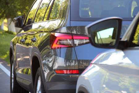 SUV vehicle pursues the same SUV vehicle on the road Stock Photo