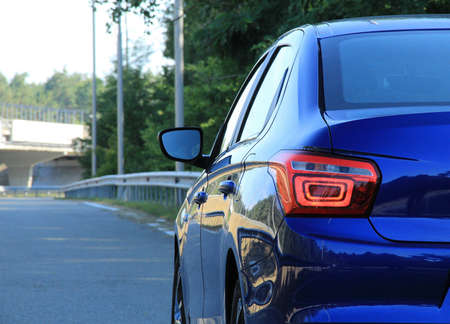 Rear lights of blue car is ready for driving on the highway