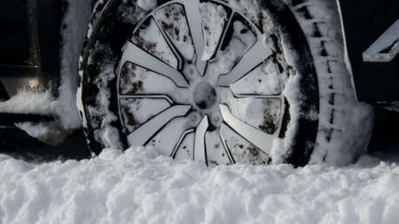 Off road truck wheels on the snow close up stock photo Stock Photo