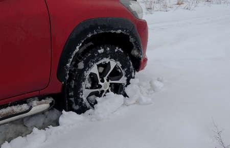 Front wheel of a light truck got a stuck in the deep snow Reklamní fotografie