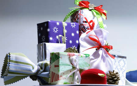 Variety Christmas gift wrapping and presents in colored boxes isolated