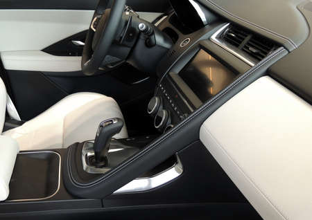 Combination of black and white leather upholstery of premium car interior