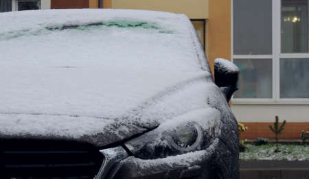 Car covered with snow and ice
