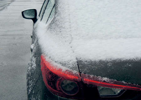Rear view of a car covered with snow