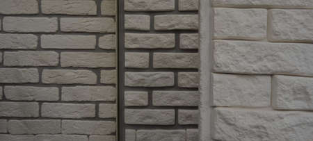 Different Types Of Artificial Masonry On The Wall Stockfoto