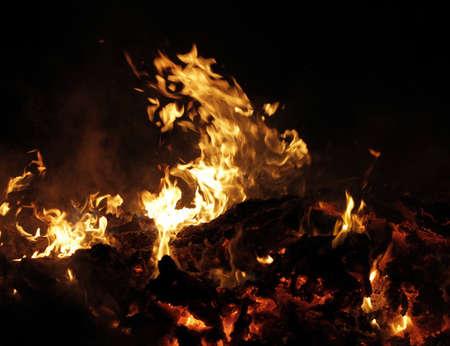 Domestic waste debris burns in fire
