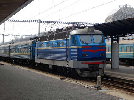 Electric Locomotive Arrival To Passenger Train Station