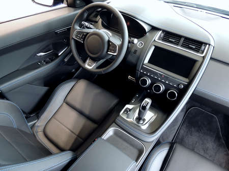 Top view of driver seat in leather stitched leather car interior Stockfoto