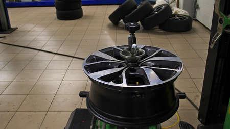 Wheel Rim Balanced In A Tire Workshop
