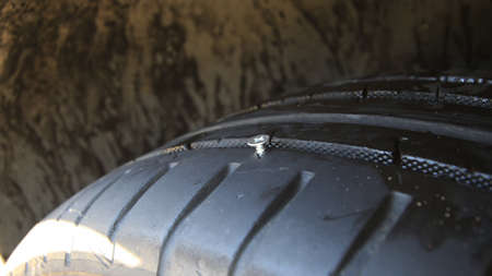 Tire Damaged By Metal Screw