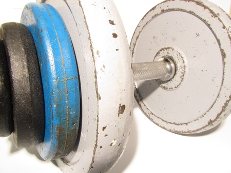 discs: old school well used dumbell for bodybuilding