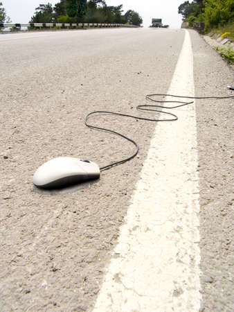 The computer mouse lays on an automobile line