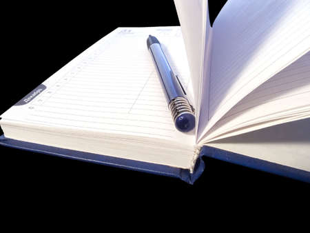 catalogs: Pencil and the open book. Black background Stock Photo