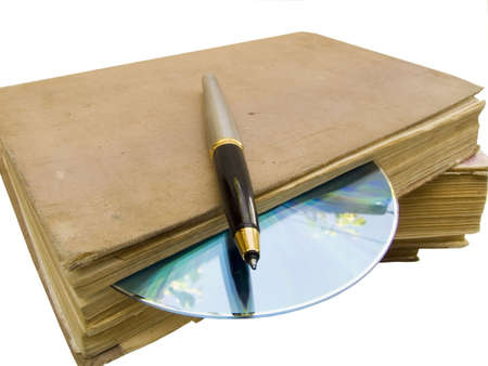 The old book, computer disk and pencil on a white background