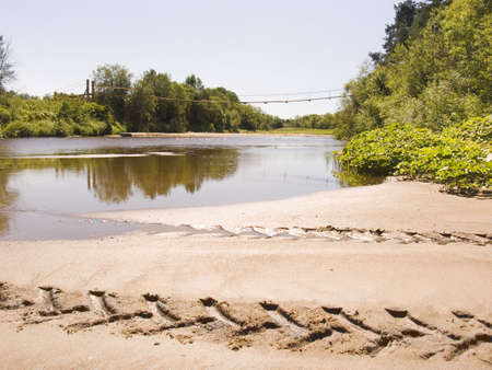 Ford on northern river. In the distance the pendant wooden bridge. photo