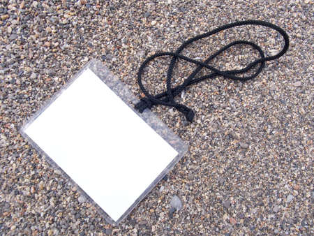 Card on a cord for access on a sea beach photo