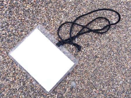 timecard: Card on a cord for access on a sea beach