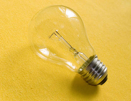 Electric lamp on a yellow background. Stock Photo - 609223
