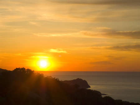 Sunrise above the sea. Bright paints.