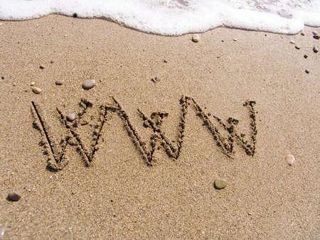 Inscription on sea sand WWW Stockfoto