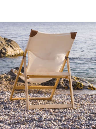Wooden chaise lounge on a sea beach. Stock Photo - 643797