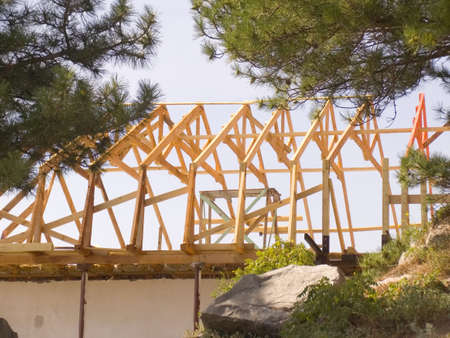 Construction of a roof of a new wooden house photo