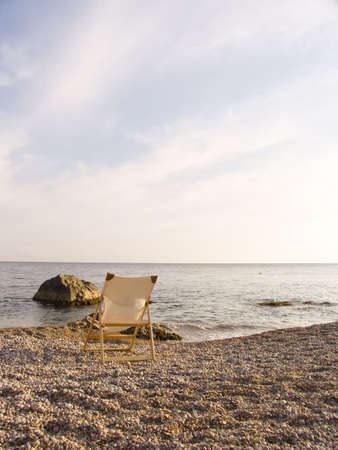 Wooden chaise lounge on a sea beach. Stock Photo - 643525