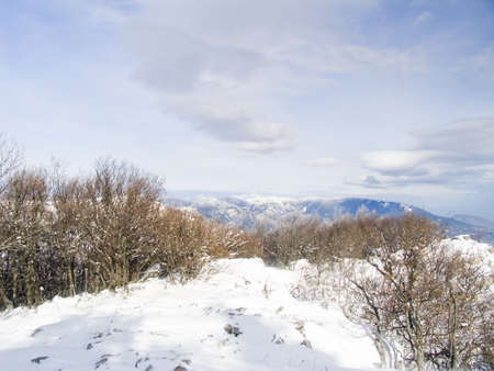 Quiet morning winter mountain landscape. In the sky beautiful clouds photo