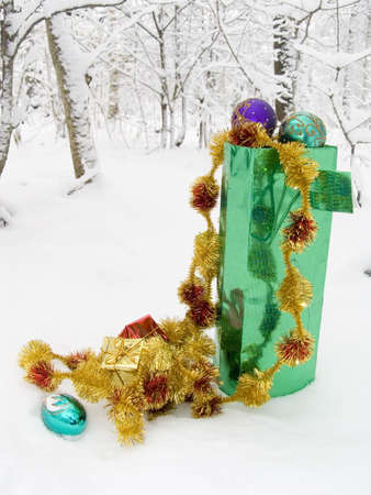 Box with gifts for Christmas on snow in a winter snow-covered wood Stock Photo - 643454