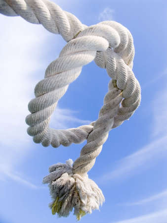 knot from a rough cord on a background of the blue sky Stock Photo