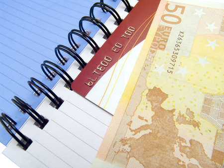 Notebook with Euro money and a credit card