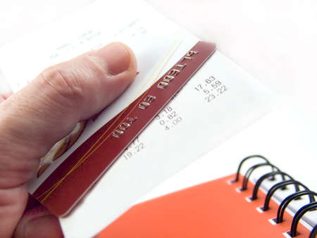The cash voucher and credit card in a hand. Stock Photo - 695276