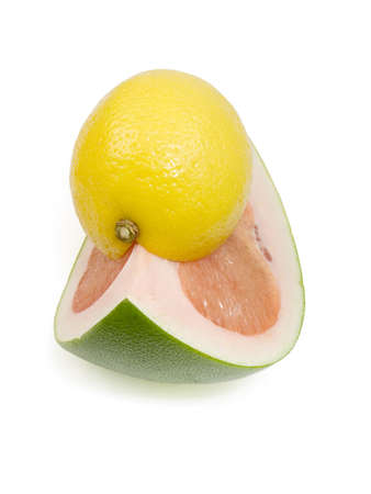pummelo: Share of a lemon and part pummelo on a white background isolated with path